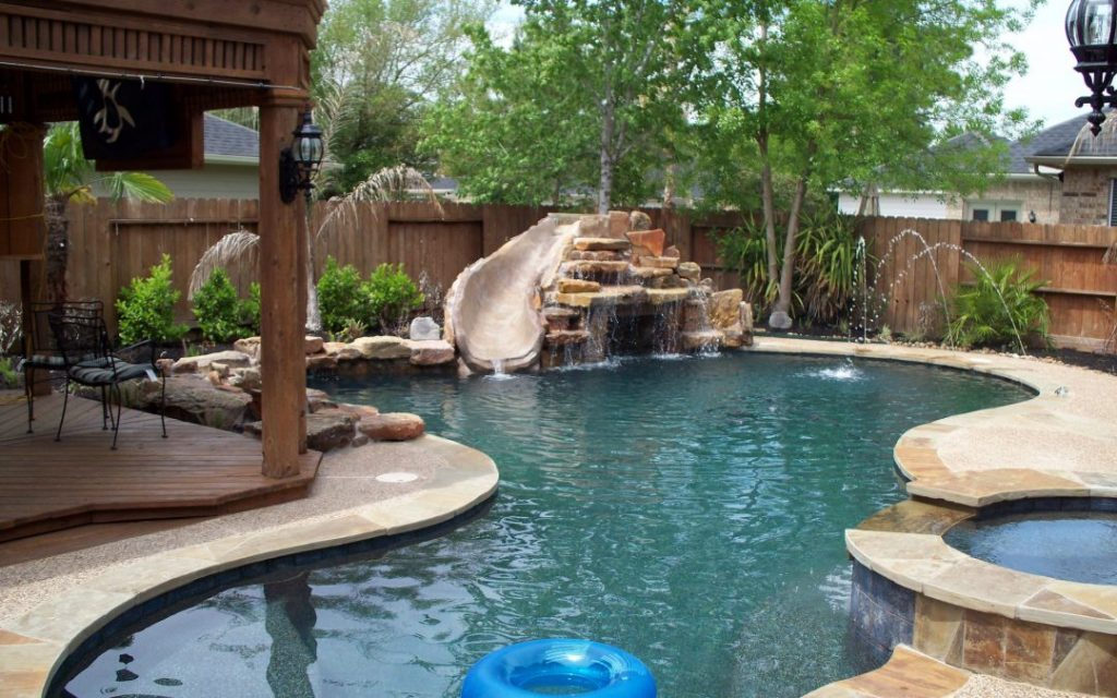 Rocked Waterfall Flowing into Custom Inground Pool Installation