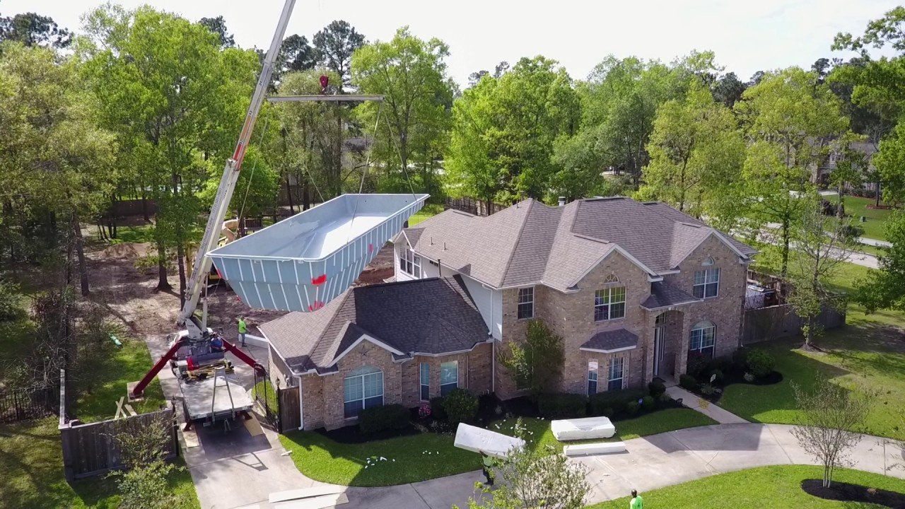 up and over - Fiberglass pool lifted over the house - YouTube