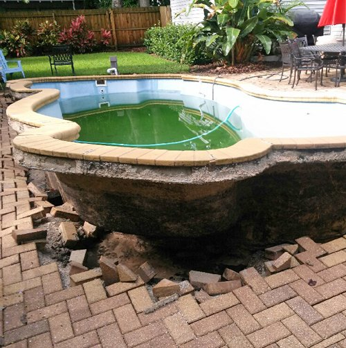 Popped Pool - What causes a pool to pop out of the ground?
