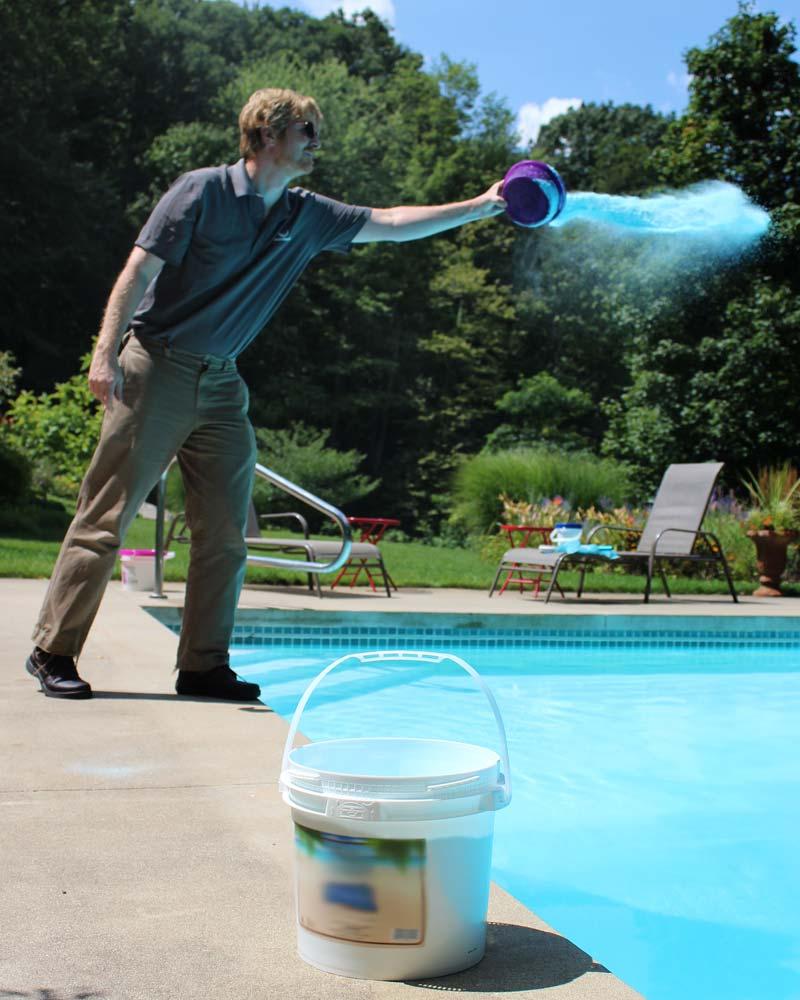 Pool Service Tech adding Borates to Inground Pool